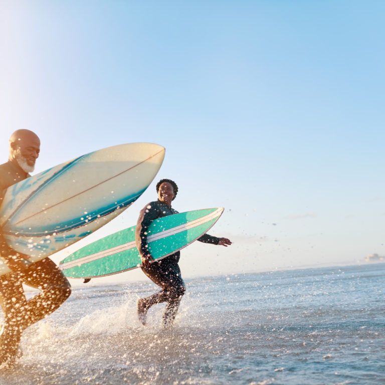 Older Couple Enjoying Renewed Health Surfing